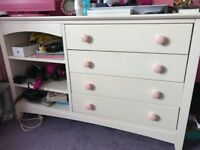 White chest of drawers with shelves