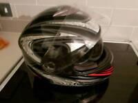 Motorbike helmet with fluo down sun visor