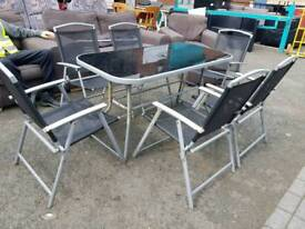 Glass topped garden table and 6 chairs set with parasol