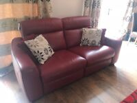 Red Leather sofas. A three Seater and a two seater electric reclining sofas.