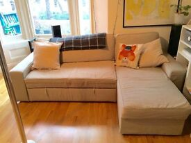 Large cream couch / sofa bed with storage