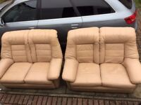2+2 SEATER SOFAS CREAM LEATHER VERY COMFY AND VERY CLEAN FROM SMOKE AND PETS FREE HOUSE