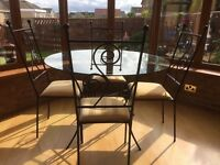 Glass and wrought iron dining table, 4ft round, 4 chairs, individually designed, excellent condition
