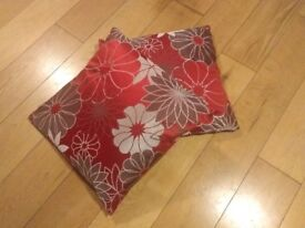 Two red & brown floral scatter cushions