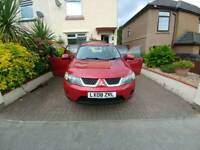 offering my outlander in red 2wd /4wd option. big spacious 5 seats with massive boot.
