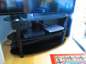 large oval black glass tv stand