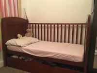 Babies R Us cotbed and mattress.