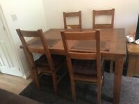 Oak coloured dining room table & four chairs