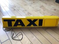 Taxi roof sign