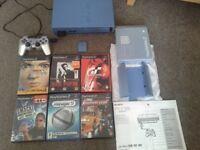 Aqua blue ps2, 1 silver controller, blue memory card, blue stand & 6 games
