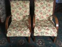 A pair of comfy retro armchairs