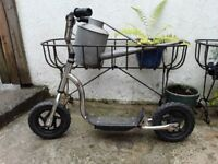 Silver scooter.