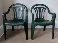Two green plastic chairs