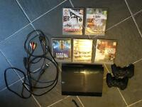 PlayStation 3 with 2 remotes + 5 games