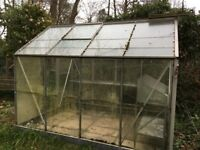 Aluminium framed greenhouse.Few glass panels missing but otherwise in good condition