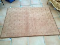 Two light peach rugs