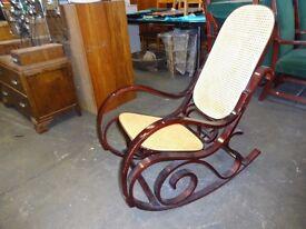 Modern rocking chair dark wood and lattice panels