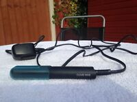 Cloud Nine The Micro Iron mini travel hair straightener. Heat guard and travel bag included.