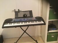 Casio LK-40, comes with stand, music stand and power adapter