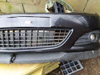 Front bumper with fog lights. Good condition.