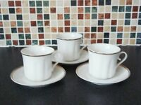 8 x White and gold fine china cups and saucers.