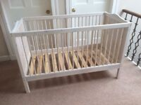White cot bed size cot.