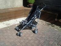 O Baby Pushchair. Black and white swirls design. Easily folded. Raincover included.