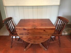 extending table 2ft x 3ft extends to 6ft x 3ft oval stained wood & 2 chairs.