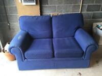 Small two seater blue sofa