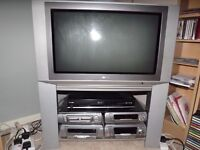 """For sale. Elderly CRTv in perfect working order 26/27"""" screen on integral stand with glass shelf."""