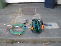 Garden hose on reel , water gun, lance and long handle brush