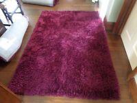 Plum shaggy rug