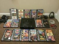 Sega Saturn console with games
