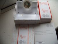 Beatrix Potter and her little tales, Benjamin Bunny silver proof 50p coin, by The Royal Mint.