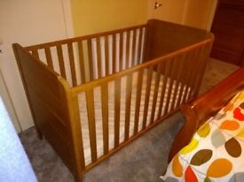 John Lewis solid wood cot bed. Adjustable height with detachable sides and short end for the bed