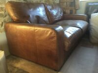 Well loved leather sofa, 2 seater but large size.