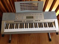 Casio CTK-4000 keyboard with stand music presets, presetting A to Z for parameters. Will sell book