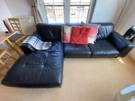 Black Leather Sofa with Chaise Longue and Matching Side Stool