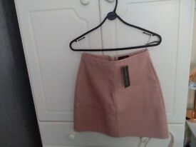 Pink leather look skirt