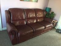 Dark red leather three seater reclining sofa