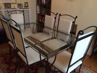6 Seater modern glass dining table and chairs for sale. £490. Collection Only