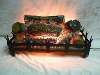 Electric log effect fire in dog grate
