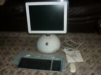 G4 IMac + a keyboard, mouse some apple software plus 4 recovery discs and 2 manals