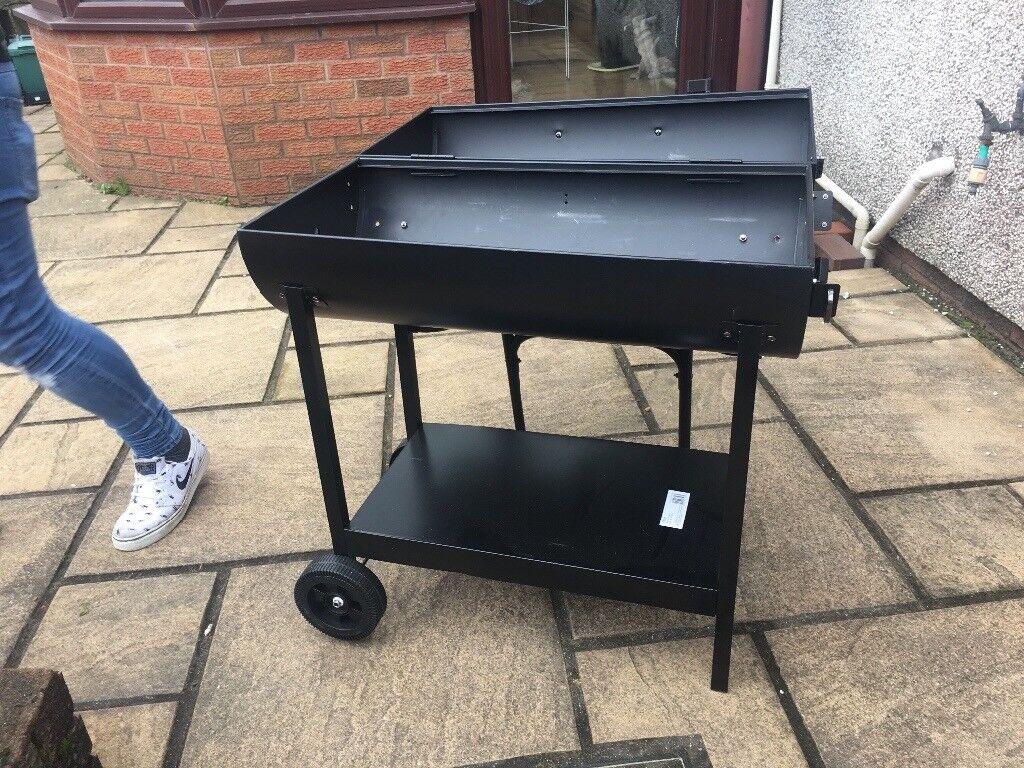 Black barrel barbecue