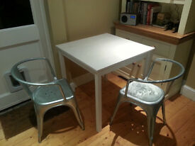 Pair of metal dining chairs for sale