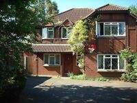 Four bedroom detached house situated on Howards Crest Close with double garage close to transport
