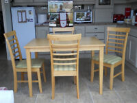 Kitchen table and 4 chairs in light hardwood (possibly ash) or other hardwood.