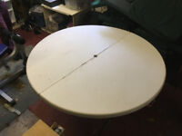 Round garden/barbecue table that folds away