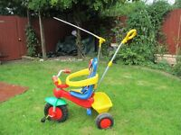 kids trike with sunshade, harness and parent handle great condition