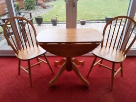Immaculate pine dining table and chairs